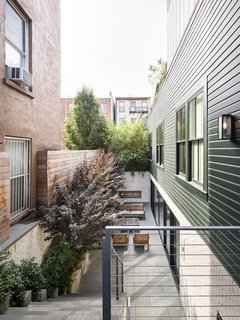 This second-floor extension, which is clad in zinc, rises from the rear of the building.