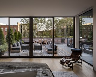 The fully glazed master bedroom opens onto a large rooftop terrace that overlooks Jersey City's Paulus Hook neighborhood.