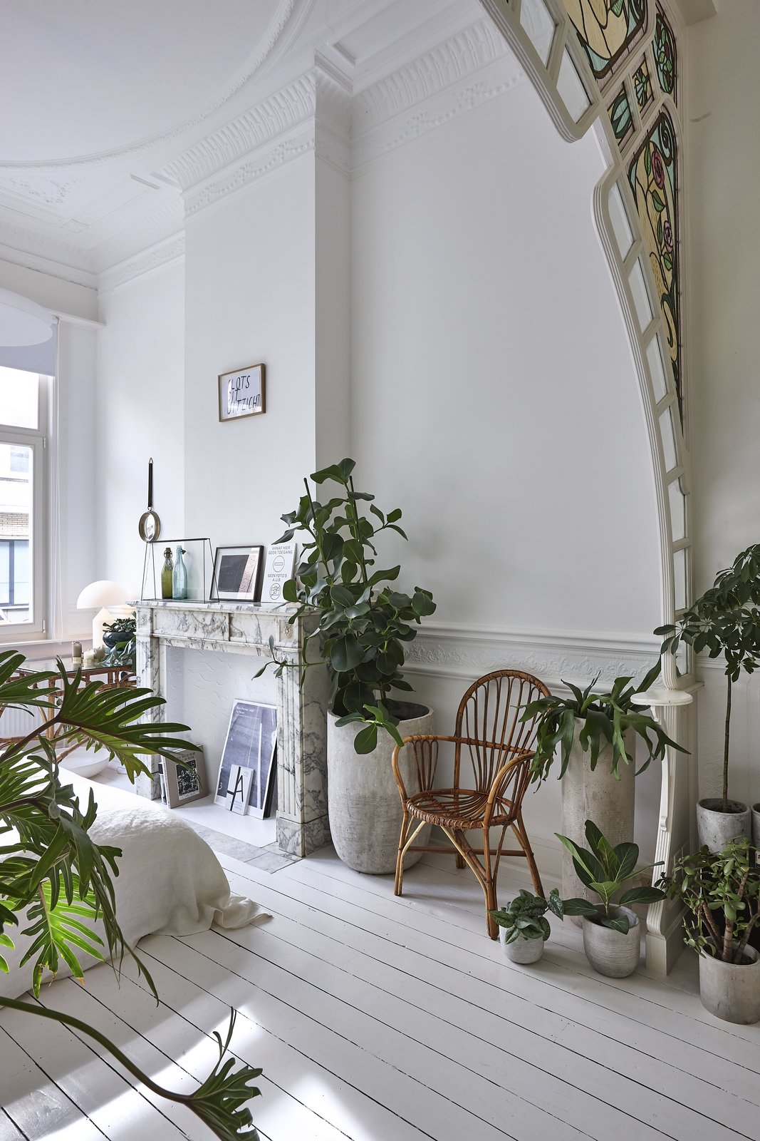 Bedroom, Bed, Chair, Table, and Painted Wood The kitchen opens out to a bright garden, and the master bedroom overlooks the streets.    Best Bedroom Painted Wood Table Photos from An Antwerp Apartment Captures the Spirit of the Belle Époque