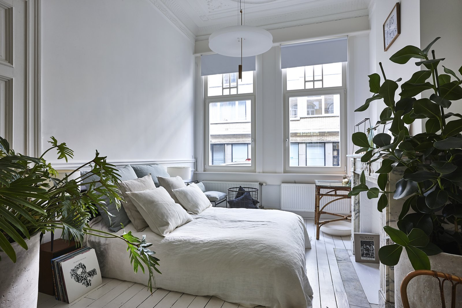Bedroom, Bed, Pendant, Chair, and Painted Wood To filter more natural light in, Taeyman also installed additional windows throughout the home.    Best Bedroom Painted Wood Bed Chair Photos from An Antwerp Apartment Captures the Spirit of the Belle Époque