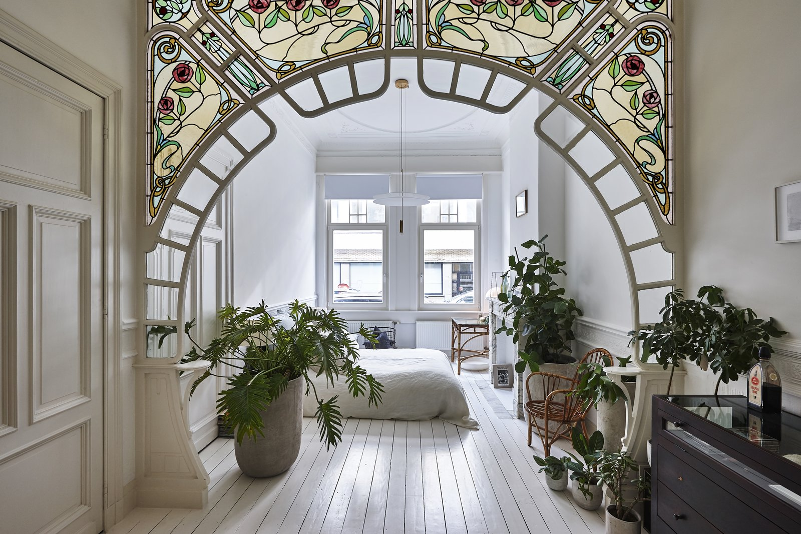 Bedroom, Pendant Lighting, Bed, Chair, and Painted Wood Floor Antwerp Apartment by Anouk Taeymans is a Best Renovation nominee.  Best Photos from An Antwerp Apartment Captures the Spirit of the Belle Époque
