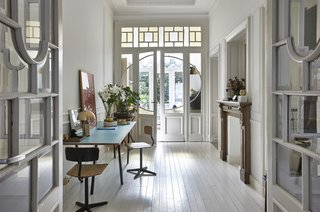 Before the revamp, the original floors were painted gray. This gave the interiors a dark and tired look, so Taeyman opted for bright white instead.