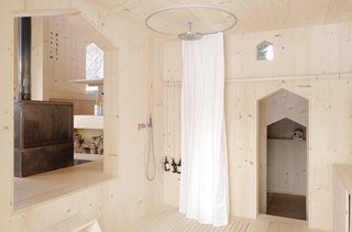 The planks are nailed vertically to the framework of the chalet, as well as its interior walls.