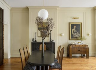 A Lawson Fenning Rough dining table by Collection Particulaire and Milo Baughman caned chairs with BBDW fabric complete the look of this room.
