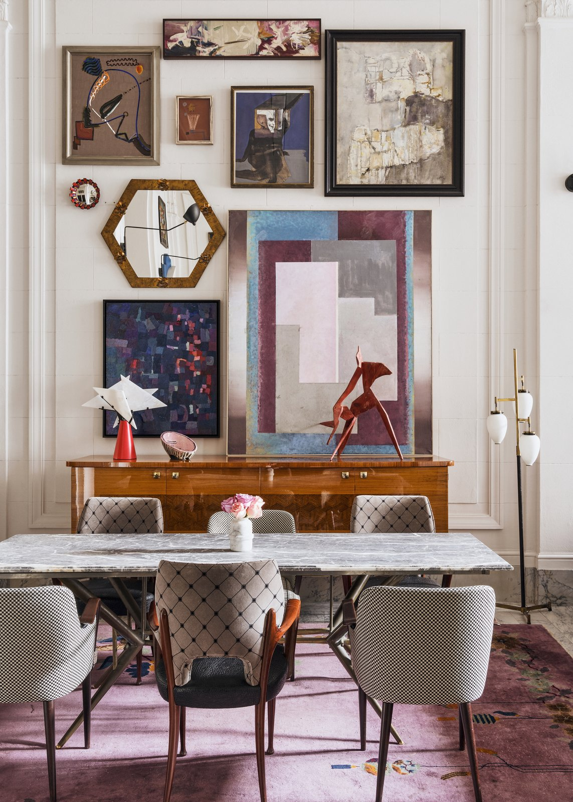 Dining Room, Chair, Floor Lighting, Rug Floor, Table, and Table Lighting Paintings by local artists, including Joe Ferriso and Jonathon Anzalone, are housed in the lobby.  Photo 6 of 12 in Old-World Charm Mixes With Bohemian Style in This New Boutique Hotel