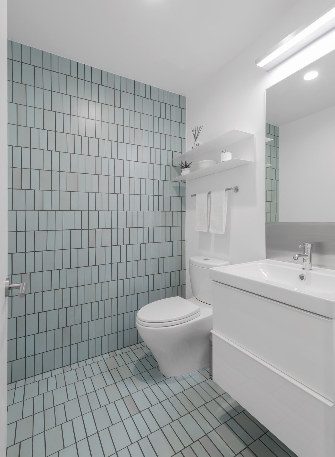 Bath, Two Piece, Ceramic Tile, Wall, and Drop In The aqua field tiles in the powder room echo the colors of the Pacific Ocean nearby.    Best Bath Ceramic Tile Drop In Photos from A Cramped Midcentury Bungalow Gets a Luminous New Addition