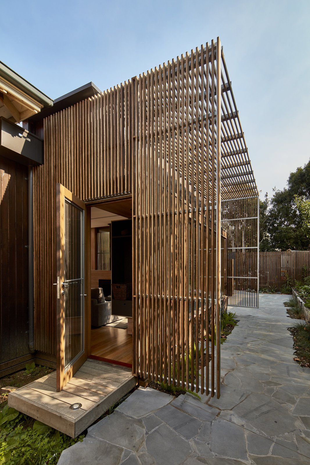 Doors, Exterior, Swing Door Type, and Wood A new addition with a steel structure clad in hardwood screens was created at the rear of the house.   Photo 3 of 17 in Wooden Screens Shade This Sustainable Melbourne Residence