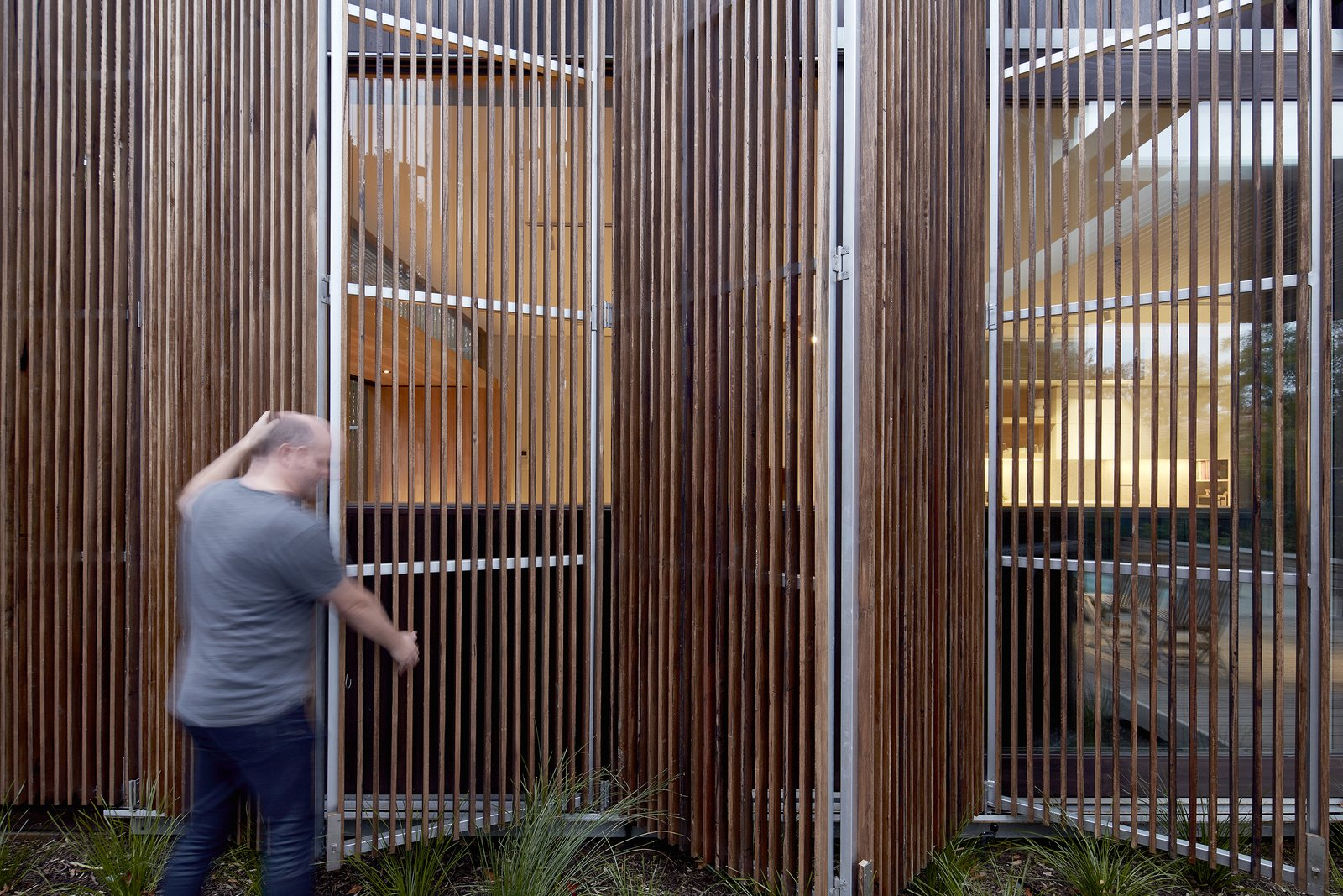 Windows, Sliding Window Type, Picture Window Type, and Wood In winter, the wooden screens can be opened to draw in the warm, afternoon sun.  Photo 13 of 17 in Wooden Screens Shade This Sustainable Melbourne Residence