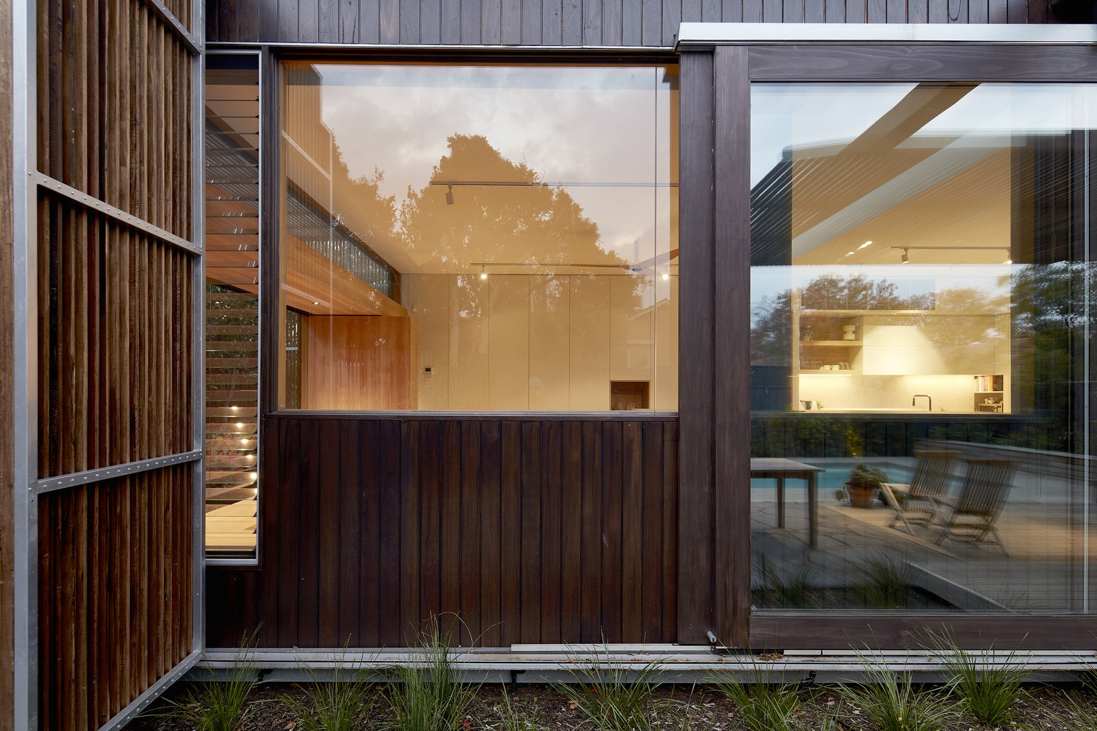 Windows, Sliding Window Type, Wood, and Picture Window Type Wilson also incorporated high levels of insulation and double glazing to make the house energy efficient.  Photo 16 of 17 in Wooden Screens Shade This Sustainable Melbourne Residence