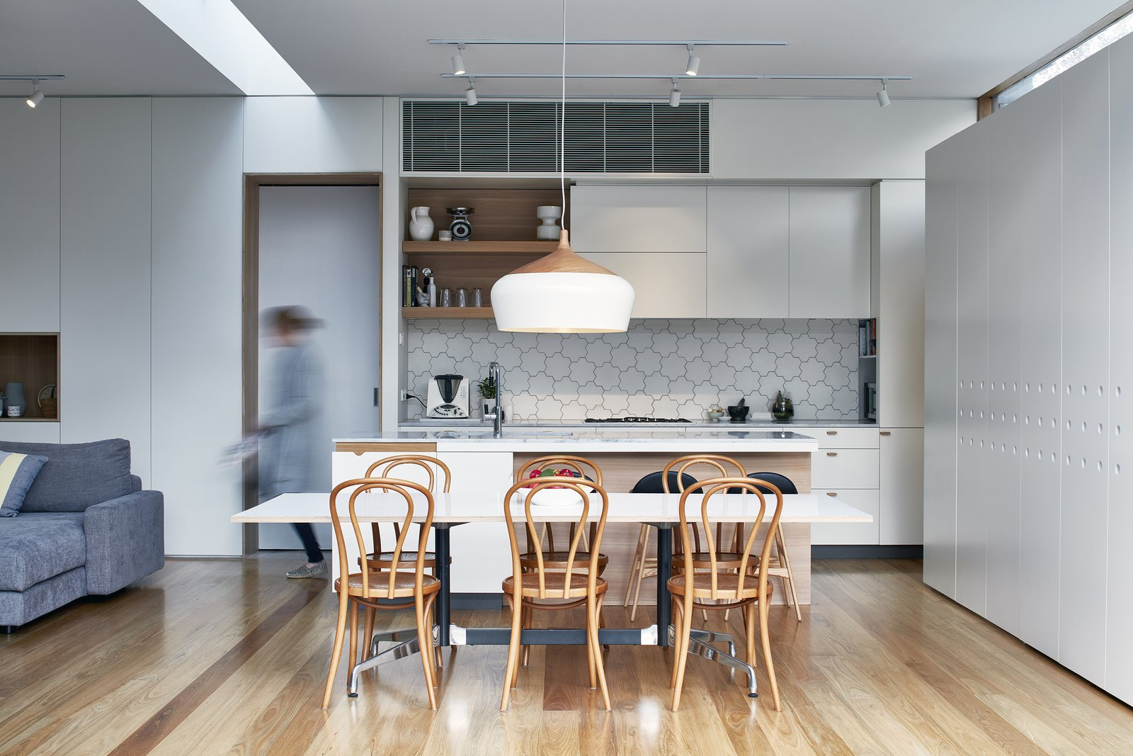 Dining Room, Table, Chair, Pendant Lighting, Light Hardwood Floor, Track Lighting, and Stools The owners also wanted better internal circulation, and upgrades for the existing rooms.  Photo 7 of 17 in Wooden Screens Shade This Sustainable Melbourne Residence