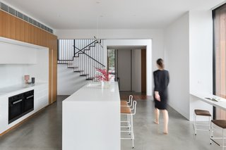 Internal brick walls and polished concrete surfaces provide thermal mass that helps to keep the interior spaces cool.