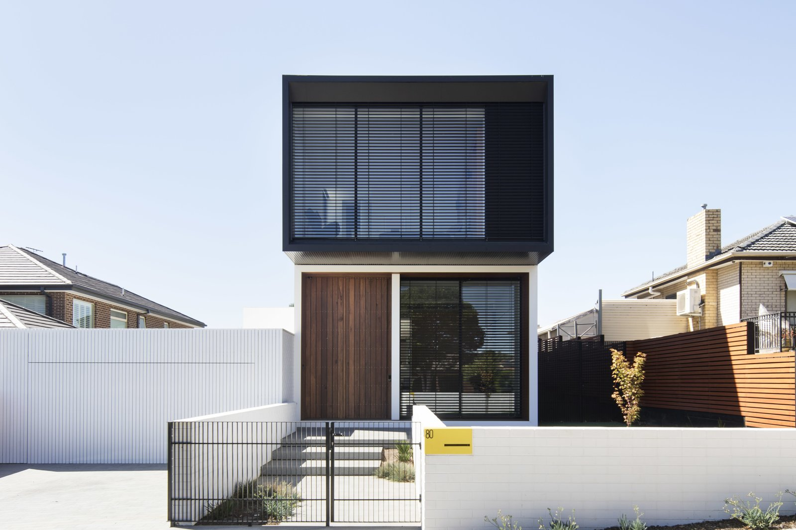 Exterior, Metal Roof Material, House Building Type, Brick Siding Material, Metal Siding Material, and Flat RoofLine The home presents a narrow facade to the street.  Photos from A Sleek Australian Dwelling Keeps its Cool With Passive Design