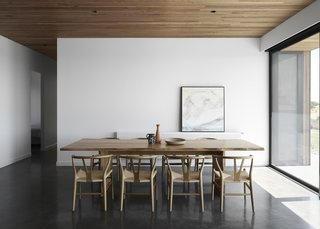 The house has floors of burnished concrete, providing thermal mass in the cooler months. The cement retains heat from the sun during the day and then slowly releases it back into the atmosphere to warm the interiors in the evening.