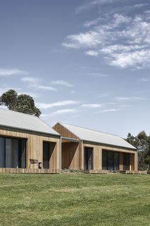 The 3,767-square-foot residence is comprised of two rural-style pavilions that are connected and clad in Blackbutt eucalyptus timber.