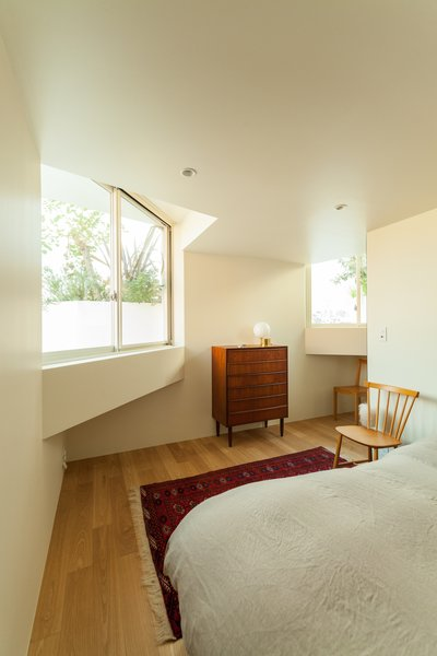 The bedrooms and gallery spaces are located within the concrete boxes.