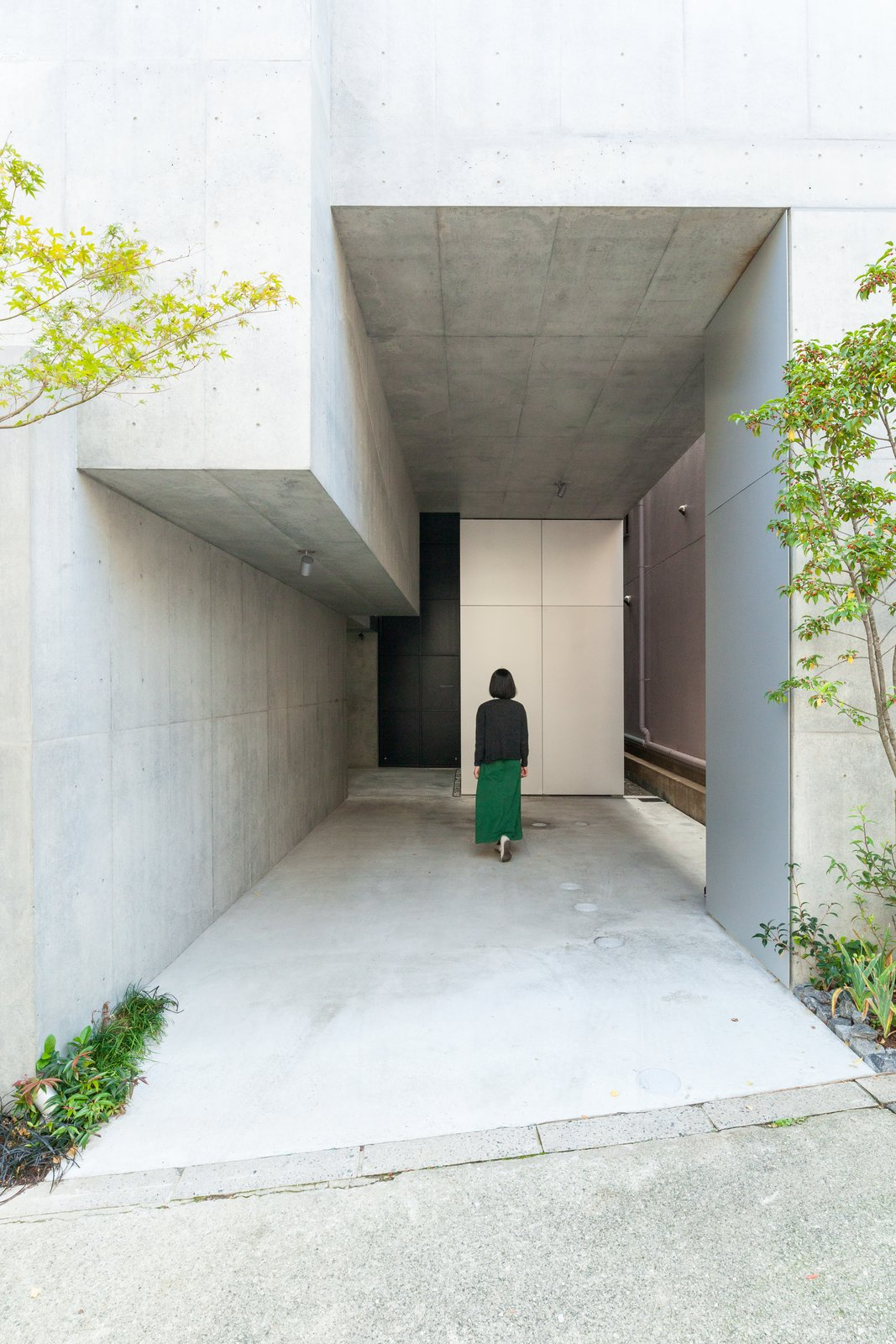 Hallway and Concrete Floor The street-level entrance to the complex.  Photo 6 of 17 in This Futuristic Japanese Building Is Not Your Everyday Tree House