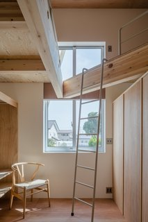 The 3,988-square-foot house has an angled roof that fits loft-like platform spaces.