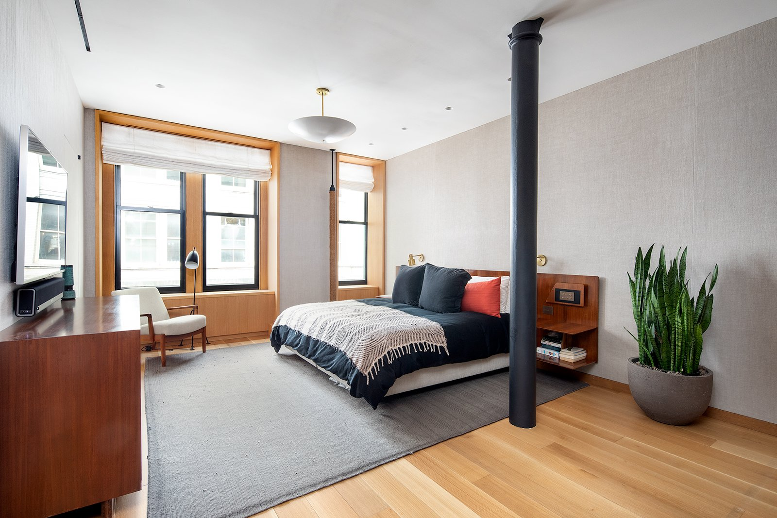 "Bedroom, Bed, Chair, Night Stands, Pendant, Rug, Recessed, Light Hardwood, Floor, and Wall To the south of the ""great room"" is a spacious master bedroom with a king-size bed.    Best Bedroom Floor Recessed Wall Chair Pendant Photos from An Updated Historic Loft in Manhattan Is Listed For $4.5M"