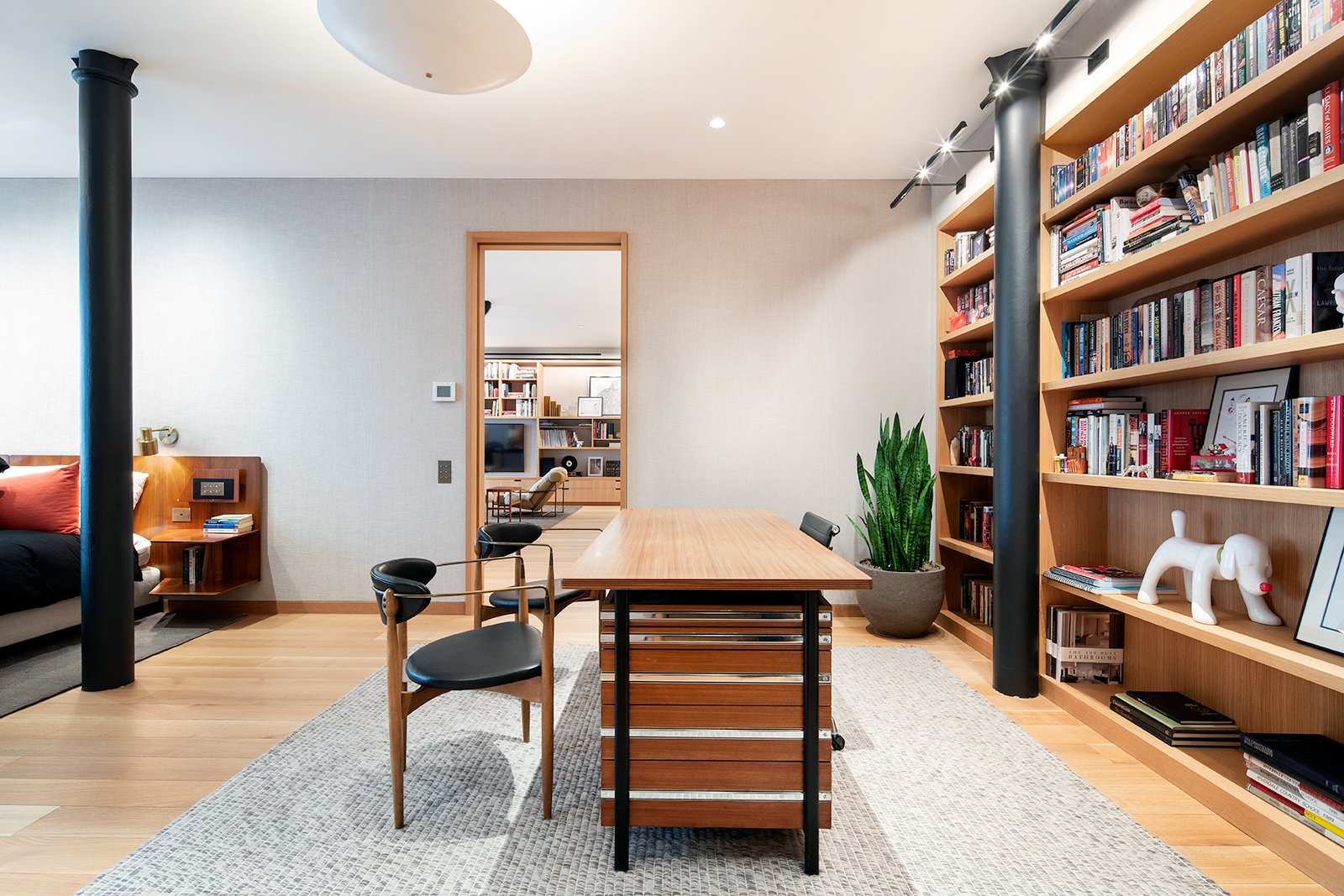 Office, Bookcase, Study, Storage, Chair, Desk, Library, Light Hardwood, Rug, and Shelves The master bedroom has enough space to accommodate a home office, library, and lounge.    Best Office Rug Light Hardwood Photos from An Updated Historic Loft in Manhattan Is Listed For $4.5M