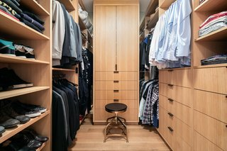 The master bedroom also includes a large walk-in closet that is clad in the same oak millwork as the living room.