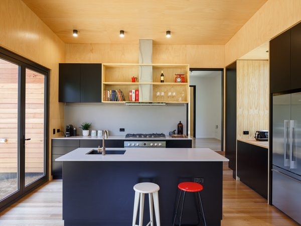 The couple wanted a home where they could relax, cook meals, listen to music together, and leave the hustle and bustle of the city behind.