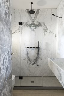 The two bathrooms feature gorgeous Carrara marble wall tiles.