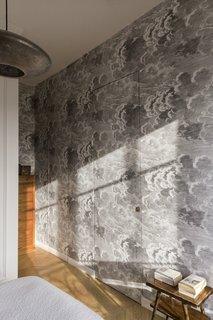 A closer look at the Fornasetti wallpaper in the bedroom.
