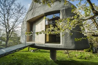 House in an Orchard rests upon a reinforced concrete foundation and resembles a mushroom with its organic shape.