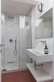 In the master bathroom, Forncae Briono tiles line the floor and walls.