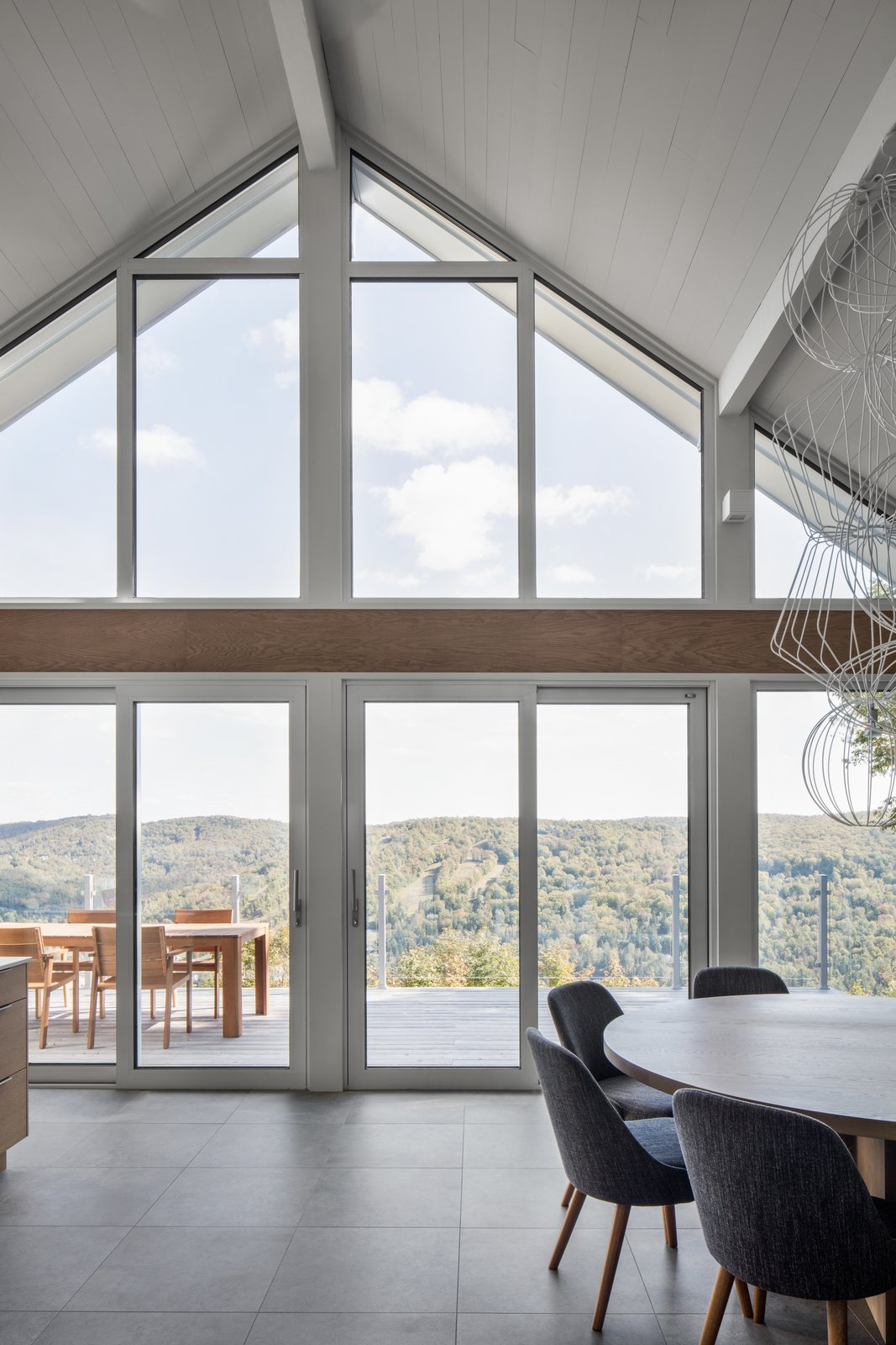 Doors, Metal, Sliding Door Type, and Exterior Hope stripped the house, but retained the foundations and frame. This allowed her to open the property up to the view of the valley by using fully-glazed doors.    Photo 6 of 13 in A 1960s Canadian Ski House Is Rebuilt Into a Gorgeous Abode