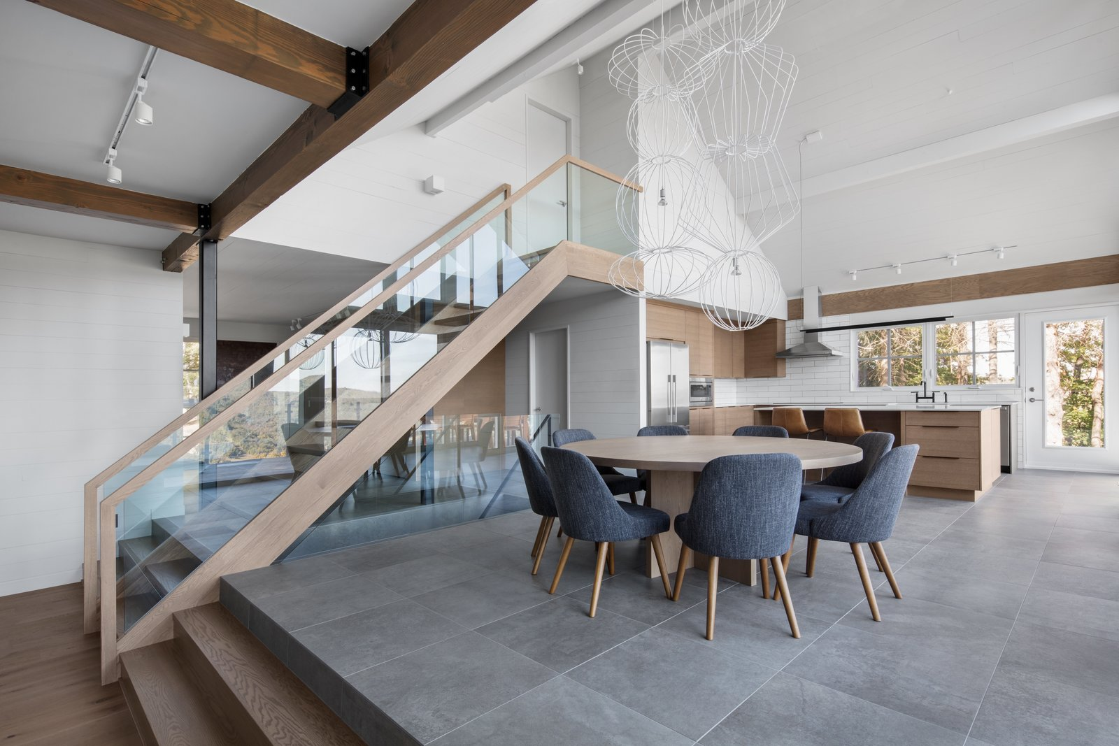 """Dining Room, Accent Lighting, Table, Chair, and Track Lighting """"A rehaul of this scale allowed me to indulge in my obsession with harmony and balance of scale, texture, weight, and flow,"""" Hope explains.    Photo 4 of 13 in A 1960s Canadian Ski House Is Rebuilt Into a Gorgeous Abode"""