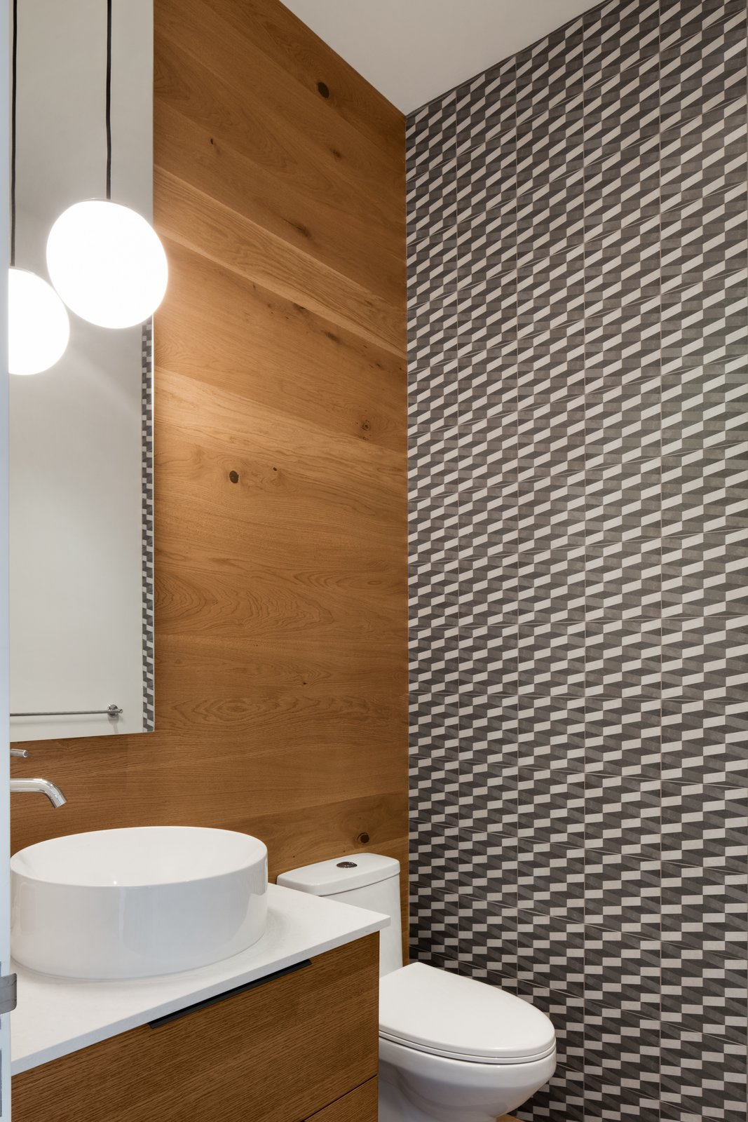 Bath Room, Pendant Lighting, Vessel Sink, and Two Piece Toilet The total cost of the project from demolition to the purchasing of brand new bedsheets was $567,996.    Photo 13 of 13 in A 1960s Canadian Ski House Is Rebuilt Into a Gorgeous Abode