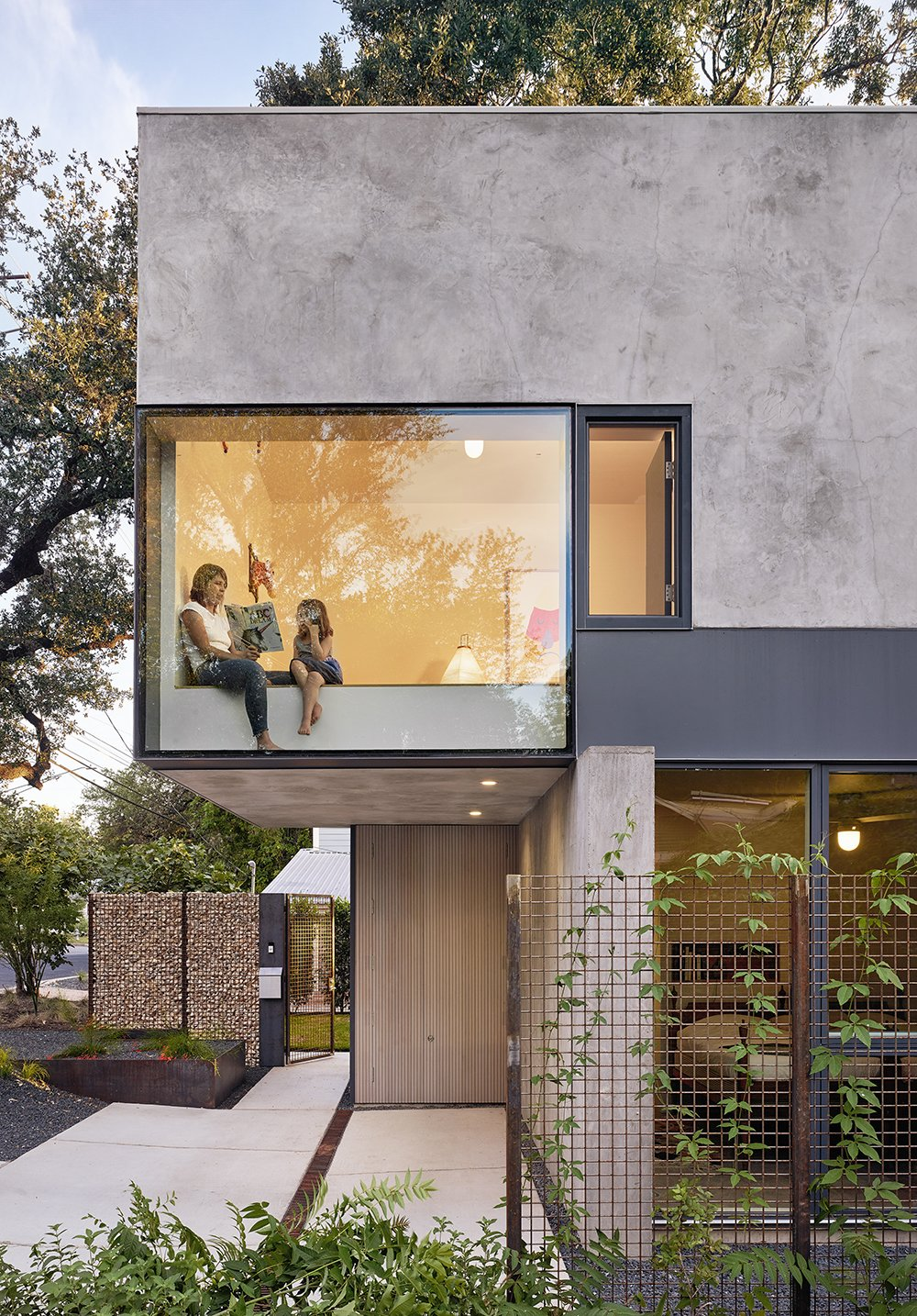 Windows, Metal, and Picture Window Type Windows and skylights have been strategically placed throughout to capture striking views of the surrounding trees. Here, a bedroom cantilevers above the entrance patio.    Best Photos from An Award-Winning Austin Home Hits the Market at $1.9M