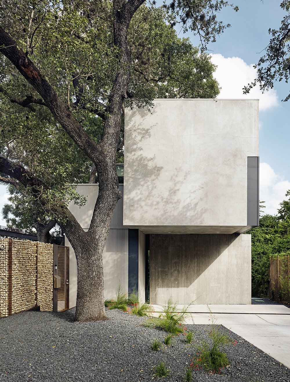 Exterior, Flat RoofLine, House Building Type, and Stucco Siding Material This massive Durand oak tree inspired the design of the house. Thanks to a wall of welded steel and tumbled limestone, the home has an abundance of privacy.     Photos from An Award-Winning Austin Home Hits the Market at $1.9M