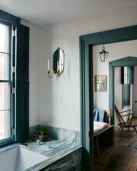 The couple's preference for raw, natural materials, tactile surfaces, and verdant color can be seen throughout the house.