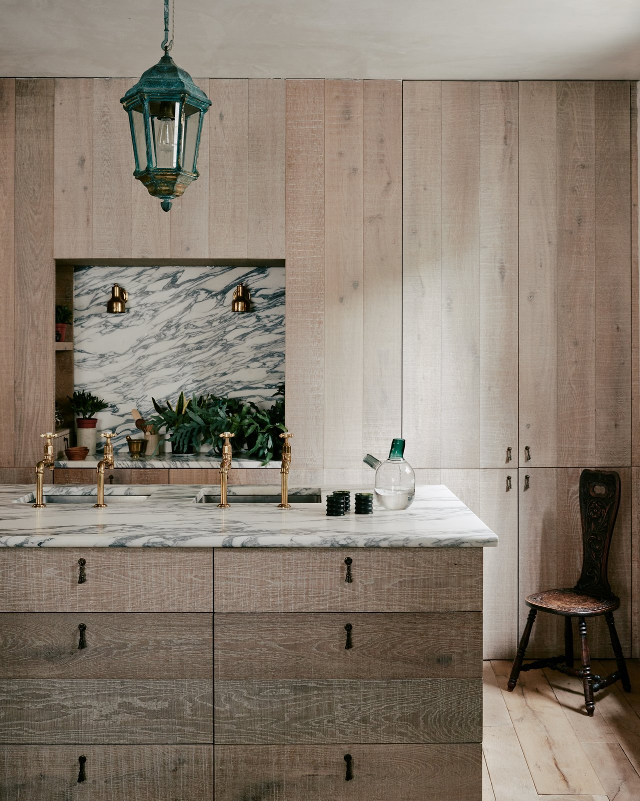Kitchen, Wood, Marble, Light Hardwood, Marble, Undermount, Wall, and Pendant Lush plants and cool shades of blue and green bring a little nature into this chic, urban home.  Kitchen Light Hardwood Wall Marble Photos from An Architect Couple Give This 18th-Century Townhouse a Sumptuous Refresh