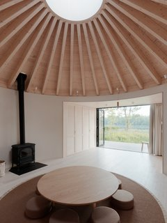 A circular skylight on the top of the domed roof draws in plenty of natural light.