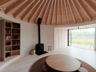 Eager to flee the city at a moment's notice, a couple who run a creative studio in Bratislava decided it was time for a weekend home. On a forested plot overlooking a lake in nearby Vojkanad Dunajom, architect Peter Jurkovič of JRKVC created a calming cabin that frames views of the countryside.