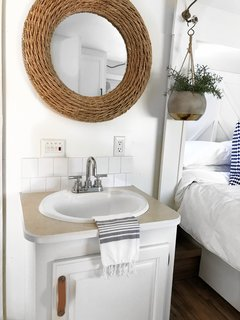 A sink and vanity in the bedroom makes use of a tight space.