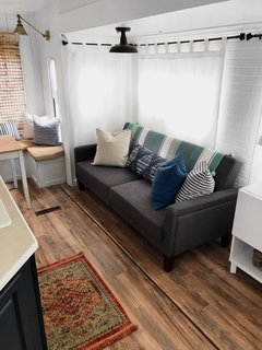 A Better Homes and Gardens Porter Fabric Tufted Futon from Walmart is a smart, small-space furniture option.
