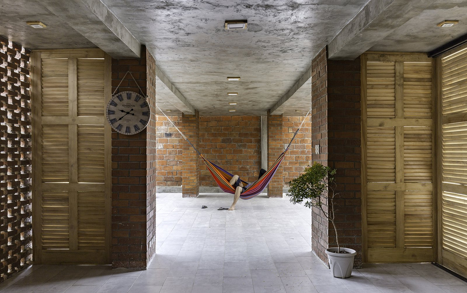 Outdoor On the other side of the ground level, next to the brick-enclosed communal area, is a resting space with hammocks for lounging.   Photo 5 of 16 in Beach Breezes Blow Right Through This Ecuadorian House on Stilts
