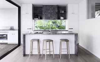 Here is a look at the new kitchen with a glass backsplash that frames views of the forest.