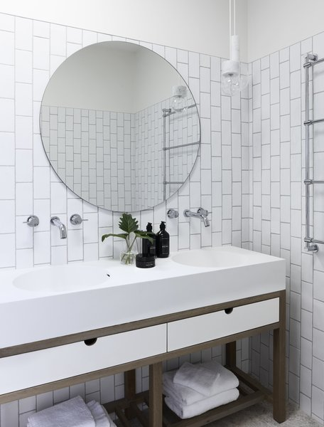 Subway Tiles Have Been Laid In A Vertical Pattern In The Bathroom To Echo  The Height