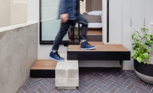 The XXX square-foot terrace is just one room wide at the front with a compact courtyard at the rear.