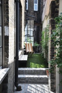 Before the renovation, the darkest corner of the home was at the back of the property. To bring light to this part of the house, Scott created an internal roof terrace on the second floor.