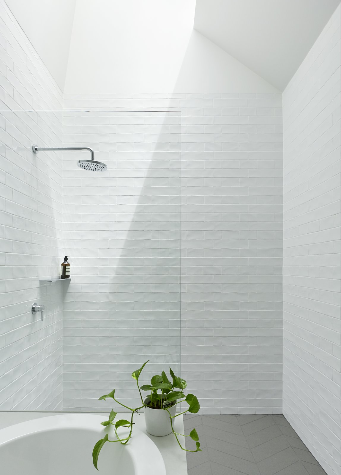 Bath Room, Open Shower, Drop In Tub, and Ceramic Tile Wall The ceramic tiles were created with irregular glaze, which mimics the reflections of the harbor nearby.   Best Photos from A Renovation Sheds New Light on a Cookie-Cutter Home in Sydney