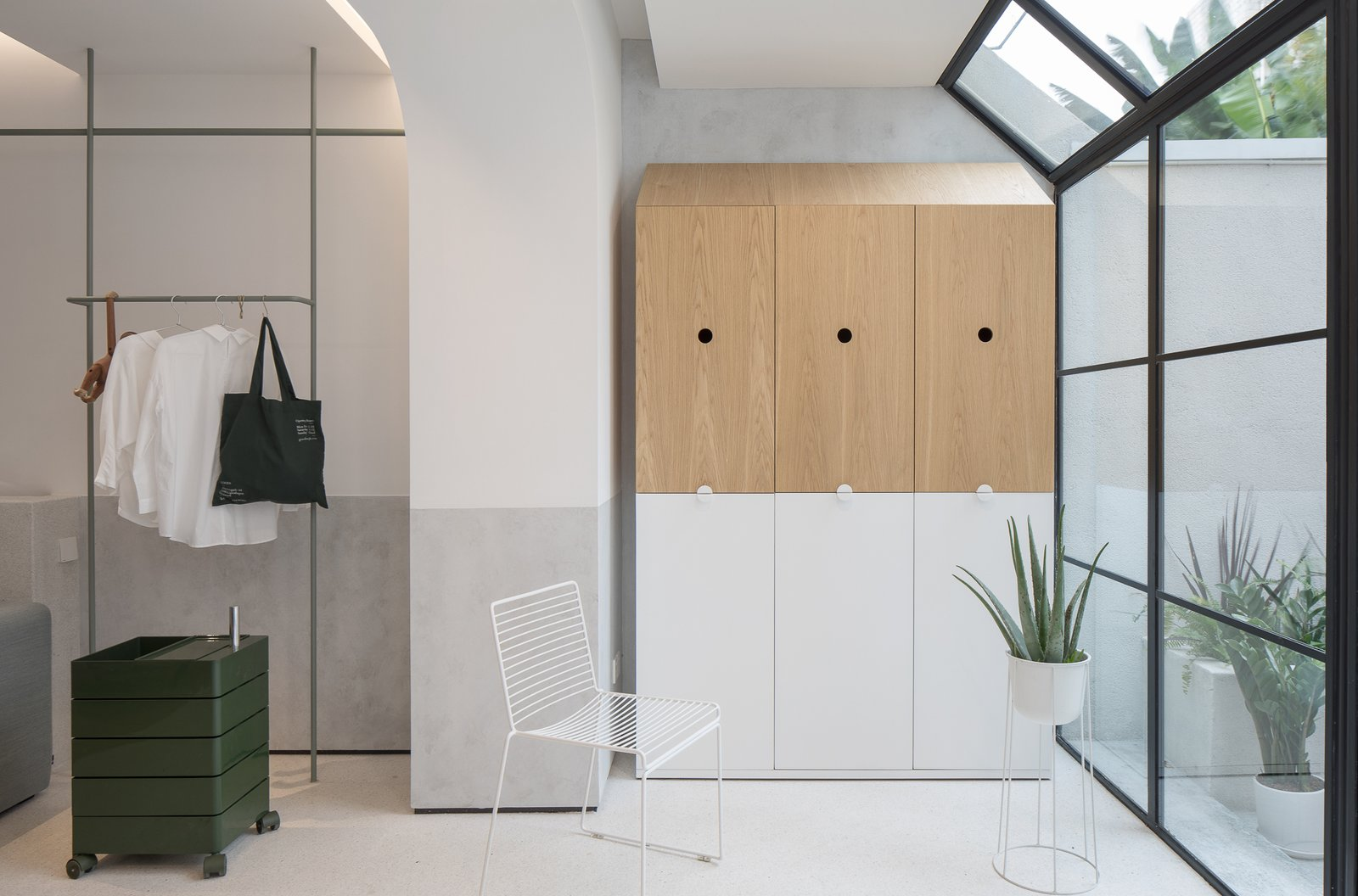 Living Room, Chair, Storage, and Accent Lighting RIGI Design reshaped the form and functionality of the interior layout.   Best Photos from A Sunny Stairwell Brings Light to an Old Shanghai Dwelling