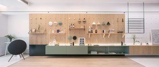 "A modular furniture wall, which the RIGI team refers to as a ""life board,"" was used as a flexible system that accommodates various storage and shelving configurations."