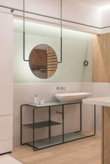 The light, clean profile of the vanity gives the bathroom a sense of spaciousness and modernity.