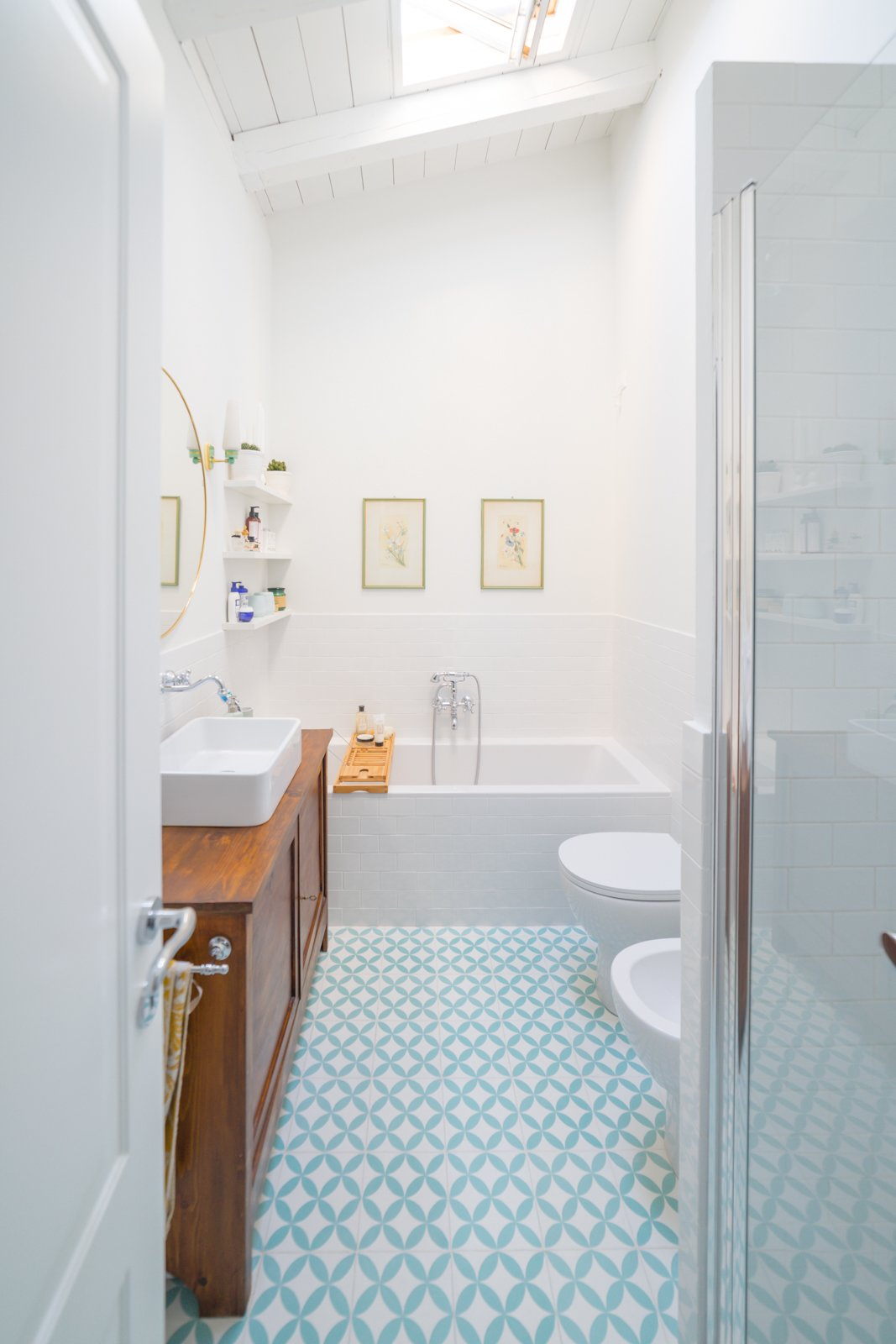 """Bath, One Piece, Soaking, Enclosed, Cement Tile, Wood, and Vessel A typical Milanese tile known as """"cementine"""" is used for the floors of the kitchen, bathroom, and service areas to create a dialogue between contemporary and traditional elements.  Best Bath One Piece Vessel Enclosed Photos from A Revamped Modern Home Is Sprinkled With Old-World Charm"""